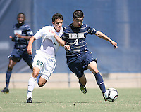 Seth C'deBaca #4 of Georgetown University grabs hold of Wesley Curtis #22 of Michigan State during an NCAA match at North Kehoe Field, Georgetown University on September 5 2010 in Washington D.C. Georgetown won 4-0.