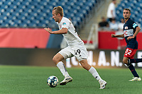 FOXBOROUGH, MA - JULY 23: Garrett McLaughlin #49 of Toronto FC II brings the ball forward during a game between Toronto FC II and New England Revolution II at Gillette Stadium on July 23, 2021 in Foxborough, Massachusetts.