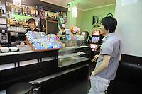- Milano, bar gestito da immigrati cinesi in via Imbonati<br /> <br /> - Milano, bar managed by Chinese immigrants in Imbonati street