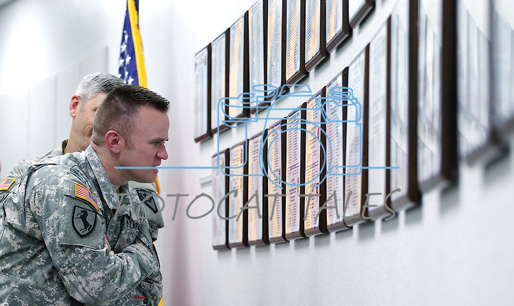 Members of the Nevada National Guard check out the newly unveiled tribute wall with the names of about 2,700 Nevada National Guard Soldiers and Airmen deployed into combat zones since Sept. 11, 2001, following a ceremony at the Office of the Adjutant General in Carson City, Nev., on Friday, April 17, 2015. <br /> Photo by Cathleen Allison