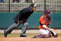 Steve Domecus #26 of the Virginia Tech Hokies blocks a low pitch as home plate umpire Danny Everett looks on at English Field March 27, 2010, in Blacksburg, Virginia.  Photo by Brian Westerholt / Four Seam Images