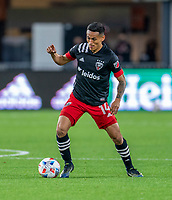 WASHINGTON, DC - APRIL 17: Andy Najar #14 of D.C. United dribbles during a game between New York City FC and D.C. United at Audi Field on April 17, 2021 in Washington, DC.