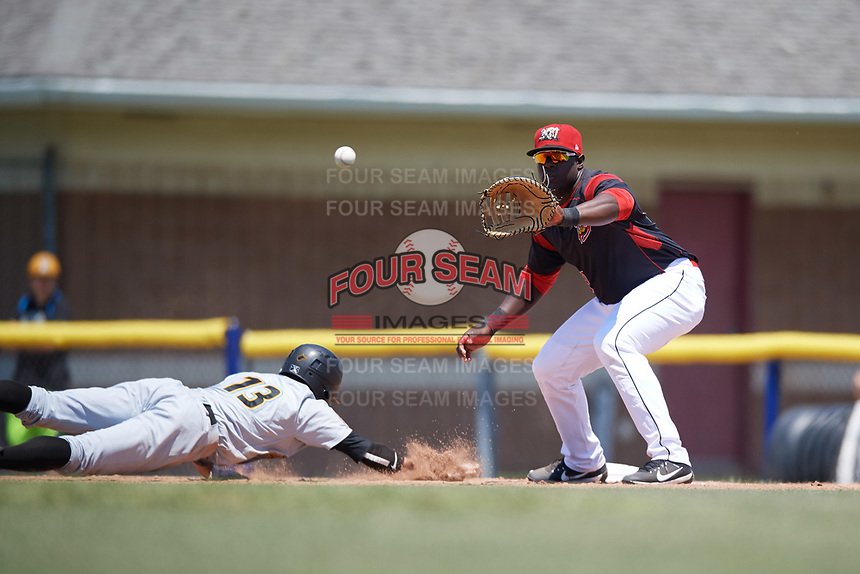 Batavia Muckdogs first baseman Lazaro Alonso (19) waits for a pickoff attempt throw as Andrew Walker (13) dives back to the first base during a game against the West Virginia Black Bears on June 25, 2017 at Dwyer Stadium in Batavia, New York.  West Virginia defeated Batavia 6-4 in the completion of the game started on June 24th.  (Mike Janes/Four Seam Images)
