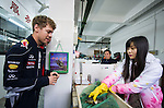 Formula One Triple World Champion Sebastian Vettel Sebastian Vettel looks at the bullfrogs on sell at a shop at the Wuzhong vegetables market during his day with Infiniti ahead of the Chinese Grand Prix on 10 April 2013 in Shanghai, China. Photo by Victor Fraile / The Power of Sport Images