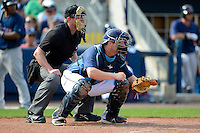 Tampa Bay Rays catcher Stephen Vogt #26 and umpire Marcus Pattillo during a Grapefruit League Spring Training game against the Boston Red Sox at Charlotte County Sports Park on February 25, 2013 in Port Charlotte, Florida.  Tampa Bay defeated Boston 6-3.  (Mike Janes/Four Seam Images)