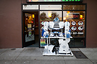 White Robot in Front of Asian Restaurant, Renton, Washington, USA.
