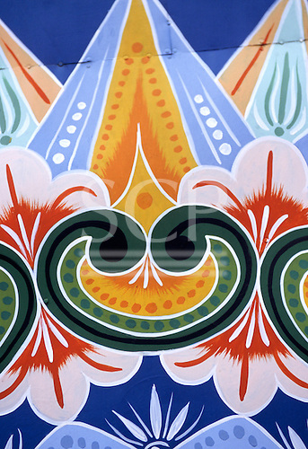 Sarchi, Costa Rica. Ox cart design by artist Carlos Chaverri in his workshop; painting ox carts 70 years since he was 7.