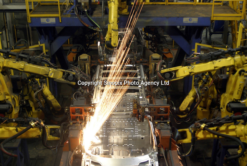 Robotic arms weld a Buick together at the Shanghai General Motors (SGM) plant in Shanghai, China. SGM is a joint-venture between General Motors and the Shanghai Automotive Industry Corporation also known as SAIC..