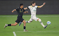 LOS ANGELES, CA - SEPTEMBER 13: Andy Najar #24 of the LAFC moves after Jorge Villafana #14 of the Portland Timbers during a game between Portland Timbers and Los Angeles FC at Banc of California stadium on September 13, 2020 in Los Angeles, California.