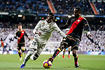 Vinicius Junior of Real Madrid (L) fights for the ball with Abdoulaye Ba, A Ba, of Rayo Vallecano during the La Liga 2018-19 match between Real Madrid and Rayo Vallencano at Estadio Santiago Bernabeu on December 15 2018 in Madrid, Spain. Photo by Diego Souto / Power Sport Images