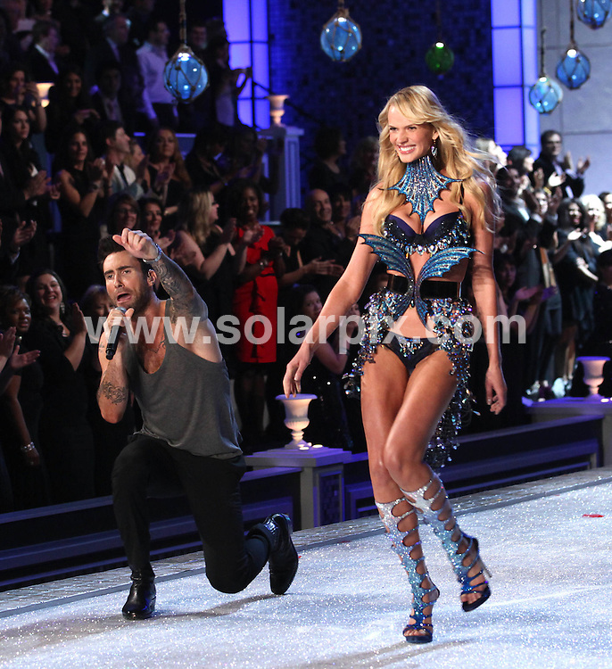 **ALL ROUND PICTURES FROM SOLARPIX.COM**                                             **SYNDICATION RIGHTS FOR UK, AUSTRALIA, DENMARK, PORTUGAL, S. AFRICA, SPAIN & DUBAI (U.A.E) & ASIA (EXCLUDING JAPAN) ONLY**                                                                                  Caption: 2011 Victoria's Secret Fashion Show  Runway and Performance at Lexington Avenue Armory in New York City, NY, USA                                                                               This pic: Adam Levine and Anne Vyalitsina                                                                                             JOB REF:14174        PHZ/Mayer       DATE:09.11.2011                                                            **MUST CREDIT SOLARPIX.COM OR DOUBLE FEE WILL BE CHARGED**                                                                      **MUST AGREE FEE BEFORE ONLINE USAGE**                               **CALL US ON: +34 952 811 768 or LOW RATE FROM UK 0844 617 7637**