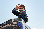 © Joel Goodman - 07973 332324  . 23/05/2011 . Manchester, UK . Carlos Tevez waves from the bus . Tens of thousands of fans line the streets of Manchester as Manchester City Football Club hold an open-topped bus parade through the city. The team are celebrating winning the FA Cup, their first trophy in 35 years, and for qualifying for next season's Champions League . Photo credit: Joel Goodman