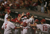 Nebraska outfielder Joe Acker (5) returns to the dugout following a score, Saturday, June 5, 2021 in the second game of the NCAA Fayetteville Regional at Baum-Walker Stadium in Fayetteville. Check out nwaonline.com/210606Daily/ for today's photo gallery. <br /> (NWA Democrat-Gazette/Charlie Kaijo)
