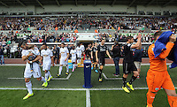 Pictured: The teams coming out of the tunnel. Saturday 23 August 2014<br /> Re: Premier League, Swansea City FC v Burnley at the Liberty Stadium, south Wales