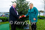 Fr Gearoid Walsh and Michelle O'Brien (Principal) of O'Brennan NS launch their 'Crenn dó Chais' Tree of Hope at the school on Monday by tying a Red Ribbon on the tree.