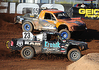 Apr 17, 2011; Surprise, AZ USA; LOORRS driver John Gaston (23) and Phil Bollman(65) during round 4 at Speedworld Off Road Park. Mandatory Credit: Mark J. Rebilas-