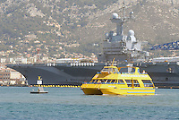 - French  Navy, Toulon naval base, Charles de Gaulle aircraft carrier and tourist boat.. ..- Marina Militare Francese, base navale di Tolone, portaerei Charles de Gaulle e battello turistico