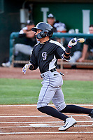 Eddy Diaz (14) of the Grand Junction Rockies at bat against the Ogden Raptors at Lindquist Field on July 23, 2019 in Ogden, Utah. The Raptors defeated the Rockies 11-4. (Stephen Smith/Four Seam Images)