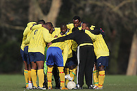 Black Meteors FC players huddle prior to the kick-off of their Hackney & Leyton Sunday League match at Victoria Park - 03/02/08 - MANDATORY CREDIT: Gavin Ellis/TGSPHOTO - Self billing applies where appropriate - Tel: 0845 094 6026