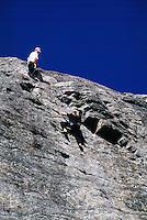 Rock Climbers / Rockclimbers rock climbing / rockclimbing at Skaha Bluffs, near Pentiction, BC, Okanagan Valley, British Columbia, Canada - No Safety Helmet Protection