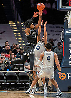 WASHINGTON, DC - FEBRUARY 19: David Duke #3 of Providence goes high over Terrell Allen #12 of Georgetown during a game between Providence and Georgetown at Capital One Arena on February 19, 2020 in Washington, DC.