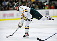 26 November 2010: University of Vermont Catamount forward Wahsontiio Stacey, a Senior from Kahnawake, Quebec, takes a slapshot against the Northeastern University Huskies at Gutterson Fieldhouse in Burlington, Vermont. The Huskies came back from a 2-0 deficit to earn a 2-2 tie against the Catamounts. Mandatory Credit: Ed Wolfstein Photo
