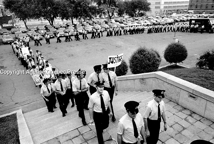 Montreal firemen walk peacefully on Montreal City Hall in August 1973 (exact date unknown)<br /> requesting a salary increase which was refused until they went on strike illegally from October 31 to November 3, 1974 resulting in over 140 buildings burned.<br /> <br /> File Photo : Agence Quebec Presse - Alain Renaud