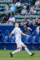 CARSON, CA - MAY 8: Jorge Villafana #19 of the Los Angeles Galaxy moves under the ball during a game between Los Angeles FC and Los Angeles Galaxy at Dignity Health Sports Park on May 8, 2021 in Carson, California.