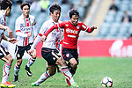 Muangthong United Midfielder Chanathip Songkrasin (R) is chased by Hwang Kiwook of FC Seoul (L) during the 2017 Lunar New Year Cup match between Muangthong United FC and FC Seoul on January 31, 2017 in Hong Kong, Hong Kong. Photo by Marcio Rodrigo Machado / Power Sport Images
