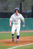 Spencer Angelis (11) of the High Point Panthers takes his lead off of third base against the Coastal Carolina Chanticleers at Willard Stadium on March 15, 2014 in High Point, North Carolina.  The Panthers defeated the Chanticleers 11-8 in game two of a double-header.  (Brian Westerholt/Four Seam Images)