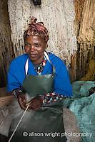 Africa, Swaziland, Malkerns. Nest organization artisan project, partnering with Coral Stephens handweaving workshop. Women carding wool. Margareth.