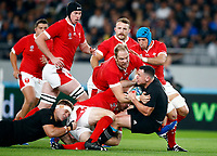 Alun Wyn Jones (capt) of Wales tackling Ryan Crotty of New Zealand (All Blacks) during the 2019 Rugby World Cup bronze final match between New Zealand All Blacks and Wales at the Tokyo Stadium at the Tokyo Stadium in Tokyo, Japan on Friday, 1 November 2019. Photo: Steve Haag / stevehaagsports.com