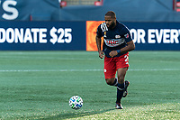 FOXBOROUGH, MA - SEPTEMBER 23: Andrew Farrell #2 of New England Revolution brings the ball forward during a game between Montreal Impact and New England Revolution at Gillette Stadium on September 23, 2020 in Foxborough, Massachusetts.