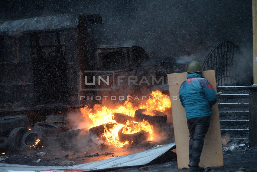 Rioters burned trtuck and buses all around the battlefield during the   protest against new draconian law to ban the right to  protest across the country.  Kiev. Ukraine