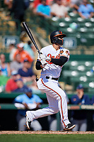 Baltimore Orioles third baseman Rio Ruiz (14) follows through on a swing during a Grapefruit League Spring Training game against the Tampa Bay Rays on March 1, 2019 at Ed Smith Stadium in Sarasota, Florida.  Rays defeated the Orioles 10-5.  (Mike Janes/Four Seam Images)