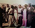 """Iraq 1984 .<br /> In Qara Dagh, Sheikh Jaffar, in the center, dancing with his wife and friends during a picnic party: """" A long time we had not been happy like this """".<br /> Irak 1984.<br /> Dans le Qara Dagh, Sheikh Jaffar, au centre, dansant avec sa femme et des amis au cours d'un pique nique:""""  Depuis longtemps  nous n'avions ete aussi heureux"""""""