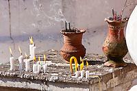 Myanmar, Burma.  Candles and Incense Burning, Shwezigon (Shwezegon)  Pagoda, Nyaung Oo, near Bagan.