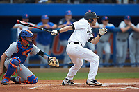 Jonathan Pryor (11) of the Wake Forest Demon Deacons follows through on his swing against the Florida Gators in the completion of Game Two of the Gainesville Super Regional of the 2017 College World Series at Alfred McKethan Stadium at Perry Field on June 12, 2017 in Gainesville, Florida. The Demon Deacons walked off the Gators 8-6 in 11 innings. (Brian Westerholt/Four Seam Images)