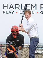 NEW YORK, NY - MAY 14: Professional baseball player Mark Teixeira and HRH Prince Harry of Wales walk together during the fifth day of his visit to the United States at Harlem RBI on May 14, 2013 in New York City. HRH will be undertaking engagements on behalf of charities with which the Prince is closely associated on behalf also of HM Government, with a central theme of supporting injured service personnel from the UK and US forces.on May 14, 2013 in New York City<br /> <br /> People:  HRH Prince Harry of Wales_Mark Teixeira