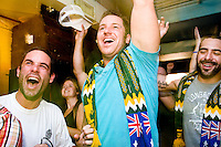 Australia fans watch their team play against Croatia on June 22, 2006 at the Sunburnt Cow, a bar in New York City.<br /> <br /> The World Cup, held every four years in different locales, is the world's pre-eminent sports tournament in the world's most popular sport, soccer (or football, as most of the world calls it).  Qualification for the World Cup is open to any country with a national team accredited by FIFA, world soccer's governing body. The first World Cup, organized by FIFA in response to the popularity of the first Olympic Games' soccer tournaments, was held in 1930 in Uruguay and was participated in by 13 nations.    <br /> <br /> As of 2010 there are 208 such teams.  The final field of the World Cup is narrowed down to 32 national teams in the three years preceding the tournament, with each region of the world allotted a specific number of spots.  <br /> <br /> The World Cup is the most widely regularly watched event in the world, with soccer teams being a source of national pride.  In most nations, the whole country is at a standstill when their team is playing in the tournament, everyone's eyes glued to their televisions or their ears to the radio, to see if their team will prevail.  While the United States in general is a conspicuous exception to the grip of World Cup fever there is one city that is a rather large exception to that rule.  In New York City, the most diverse city in a nation of immigrants, the melting pot that is America is on full display as fans of all nations gather in all possible venues to watch their teams and celebrate where they have come from.