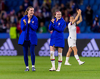 LE HAVRE,  - JUNE 20: Tierna Davidson #12 and Rose Lavelle #16 take a lap around the field during a game between Sweden and USWNT at Stade Oceane on June 20, 2019 in Le Havre, France.