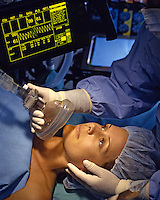 Anesthesiologist moniters a surgical patient.<br />