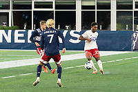 FOXBOROUGH, MA - OCTOBER 16: Nkosi Burgess #29 of North Texas SC passes the ball under pressure during a game between North Texas SC and New England Revolution II at Gillette Stadium on October 16, 2020 in Foxborough, Massachusetts.