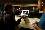 Mountain Lion (Puma concolor) biologists, Max Allen and Chris Fust, looking at satellite tracking data before looking for den, Santa Cruz Puma Project, Santa Cruz, Monterey Bay, California