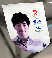 A Visa advert featuring Chinese 110 meters hurdler Liu Xiang in Beijing. After years of hype and multi-million dollar endorsements Liu Xiang disappointed the whole of China and failed before the first hurdle and is out of the games with injury..
