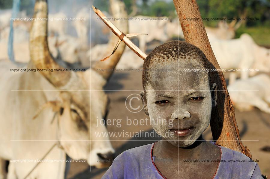 SOUTH SUDAN Bahr al Ghazal region , Lakes State, village Yeri cattle camp near Rumbek, Dinka boy Mathou, 11 years old, with Zebu cow / SUED-SUDAN  Bahr el Ghazal region , Lakes State, Dorf Yeri, Dinka mit Zebu Rindern im cattle camp bei Rumbek , Junge Mathou 11 Jahre
