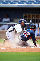 GCL Rays catcher Jovany Felipe (25) tags Yomar Valentin (46) sliding into home during the second game of a doubleheader against the GCL Red Sox on August 4, 2015 at Charlotte Sports Park in Port Charlotte, Florida.  GCL Red Sox defeated the GCL Rays 2-1.  (Mike Janes/Four Seam Images)
