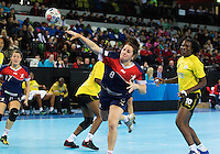 23 NOV 2011 - LONDON, GBR - Britain's Louise Jukes (#8, in blue) shoots during the 2011 London Handball Cup match against Angola at The Handball Arena in the Olympic Park in Stratford, London  (PHOTO (C) NIGEL FARROW)