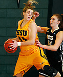 JANUARY 23, 2015 -- Logan Cowan #44 of Black Hills State shields the ball from defender Kellie Krueger #44 of UC-Colorado Springs during their Rocky Mountain Athletic Conference women's basketball game Friday at the Donald E. Young Center in Spearfish, S.D.  (Photo by Dick Carlson/Inertia)