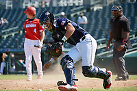 Catcher Rene Lastres (23) retrieves the ball in foul territory during the Baseball Factory All-Star Classic at Dr. Pepper Ballpark on October 4, 2020 in Frisco, Texas.  Rene Lastres (23), a resident of Miami, Florida, attends Calvary Christian Academy.  (Mike Augustin/Four Seam Images)
